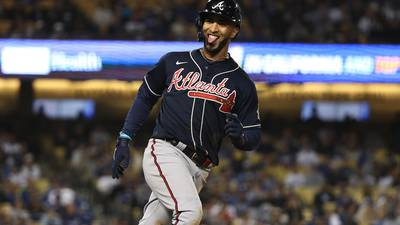 PHOTOS: Braves extend lead over Dodgers with crucial Game 4 win