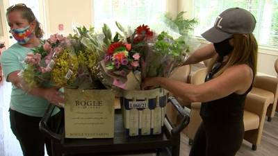 """Local store employees continue pandemic """"Flower Days"""" visits to Dunwoody Assisted Living Center"""
