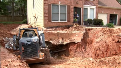 Roswell family say they're getting no help keeping their home from falling into trash sinkhole