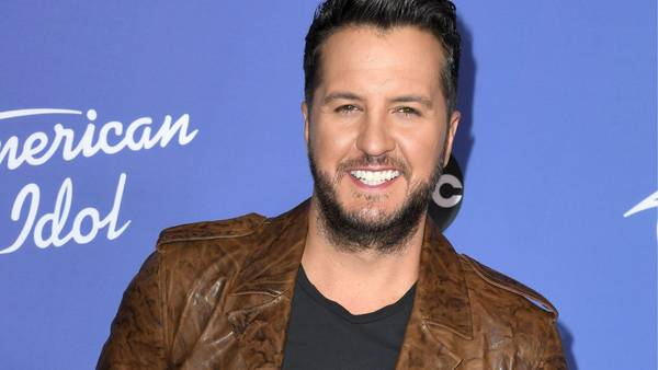 Georgia's Luke Bryan helps woman stranded on the side of the road with flat tire