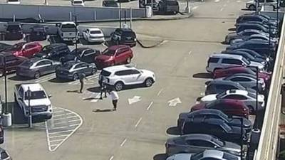 SURVEILLANCE VIDEO: Man robbed and shot at by thieves in parking lot of Lenox Square