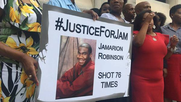 Mother of man shot 76 times speaks out after 2 officers indicted