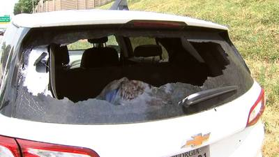 Police investigating after car shot up driving along I-20 in DeKalb County