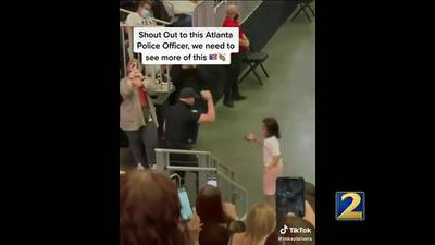 Atlanta officer dances with young fan before Marc Anthony concert