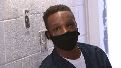 'I'm scared,' man seen pinned in viral video says from jail