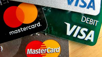 Credit card companies are slashing people's credit limits without telling them