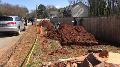 DeKalb County officials apologizing after bodies found buried under road