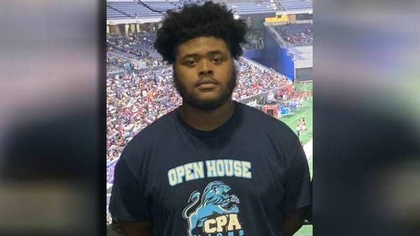 911 calls dispute how many people were on elevator that pinned, crushed football player