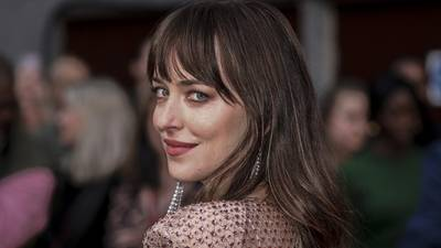 Photos: Dakota Johnson, Olivia Colman stun on 'The Lost Daughter' red carpet