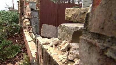 County to pay damage after man hit open manhole, crashed into brick wall